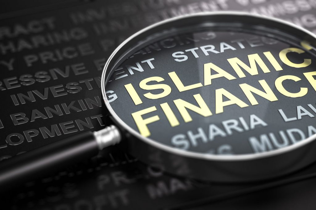 3D illustration of a magnifier over the text Islamic finance written with golden letter. Black background.
